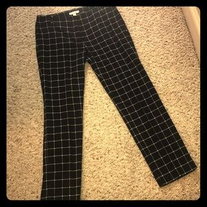 Ankle pants, black and grey with a little white.